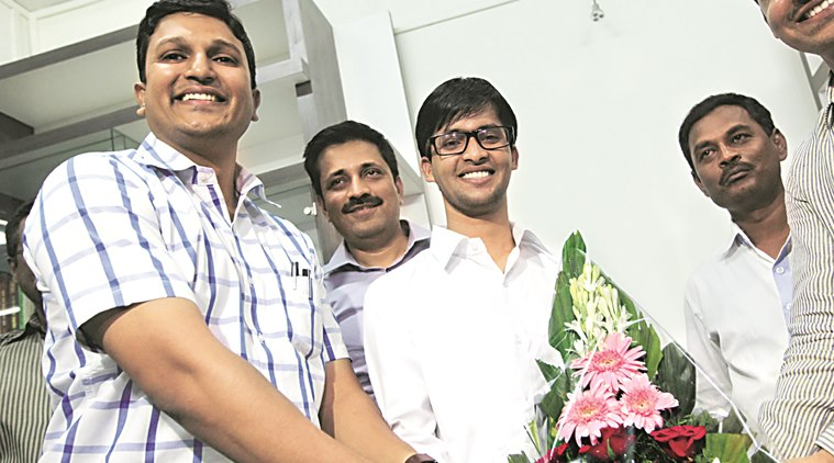 21-year-old Ansar Ahamad Shaikh, who cracked UPSC at his first attempt ranking 361 congratulated his tutor Rahul Tukaram Pandve who also cleared the UPSC with rank 200. Express photo By Sandeep Daundkar,Pune,10.05.2016