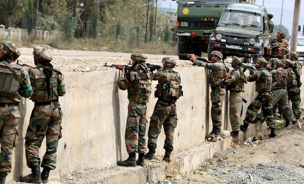 Army jawans take positions during an encounter