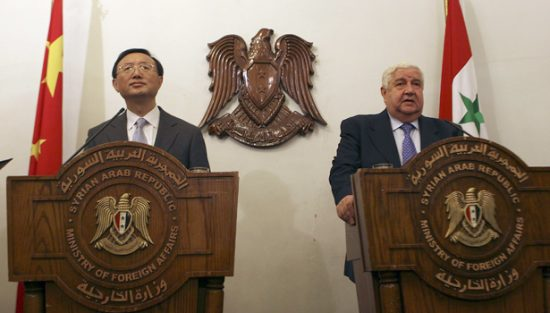 Syrian Foreign Minister Walid al-Moallem, right, speaks during a joint press conference with his Chinese counterpart Yang Jiechi, left, in Damascus, Syria, on Sunday April 26, 2009. Israel's foreign minister said Sunday that he was willing to sit down immediately with Syria to talk peace if there would be no preconditions, after having declared days earlier that Damascus was no partner for peace.(AP Photo/Bassem Tellawi).
