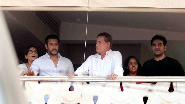 Indian Bollywood actor Salman Khan (2L), mother Salma, (L), father Salim Khan (C), sister Arpita (2R) and Arbaaz Khan stand on the balcony on arrival at his house in Galaxy Apartment after getting bail from his ongoing trial of hit and run case, in Mumbai on May 8, 2015.  Bollywood superstar Salman Khan's five-year prison sentence for killing a homeless man with his SUV after a night out drinking 13 years ago was suspended on May 8, 2015, pending an appeal.    AFP PHOTO        (Photo credit should read STR/AFP/Getty Images)